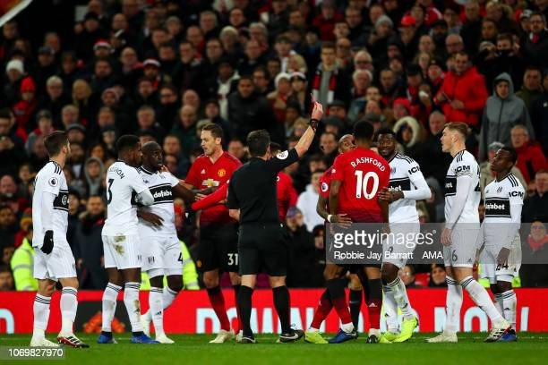 AndreFrank Zambo Anguissa of Fulham receives a red card for two yellow cards during the Premier League match between Manchester United and Fulham FC...