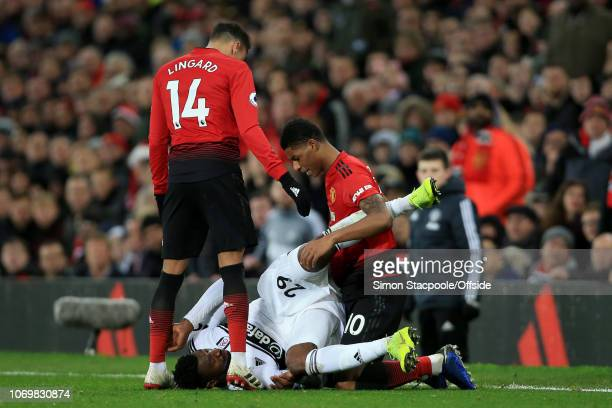AndreFrank Zambo Anguissa of Fulham tangles with Marcus Rashford of Man Utd during the Premier League match between Manchester United and Fulham at...