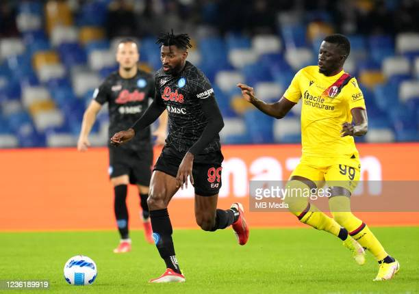 Andre-Frank Zambo Anguissa of SSC Napoli competes for the ball with Musa Barrow of Bologna FC ,during the Serie A match between SSC Napoli and...