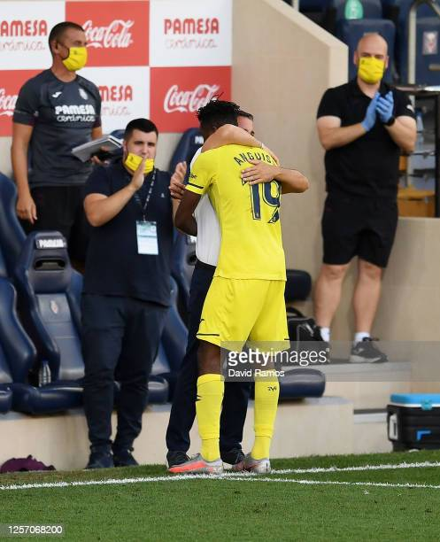 Andre-Frank Zambo Anguissa of Villarreal celebrates with Javier Calleja, Manager of Villarreal after scoring his team's first goal during the Liga...