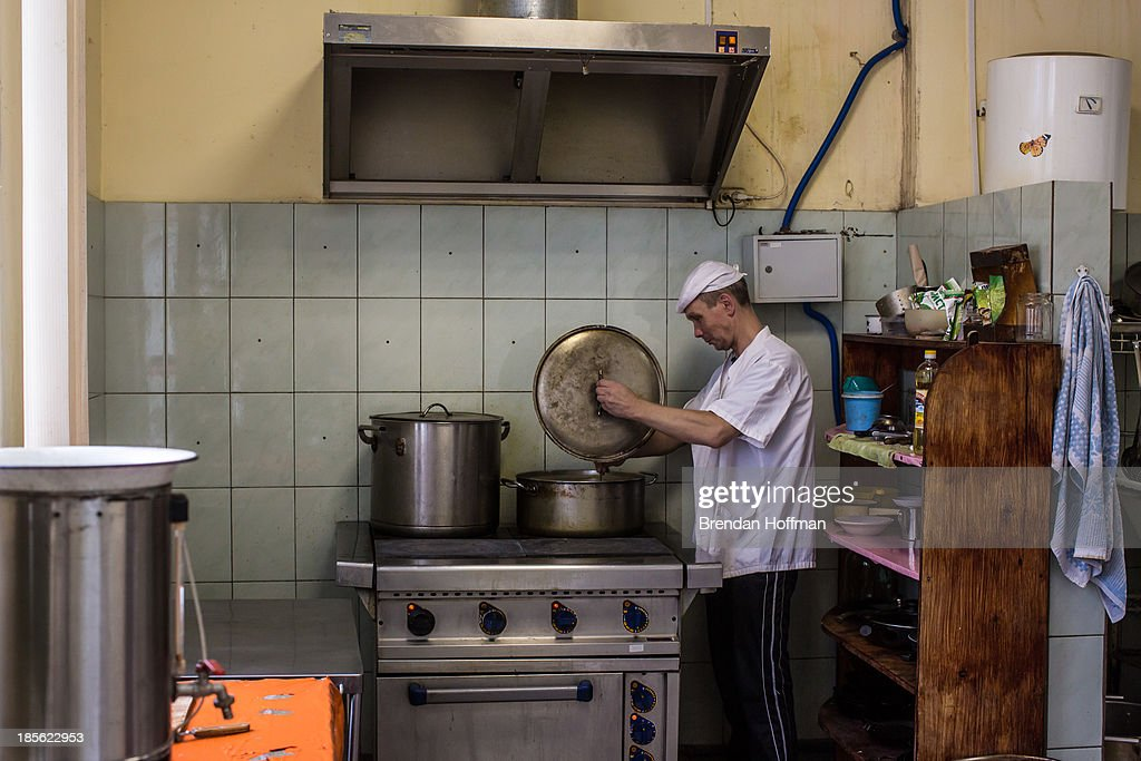 Andrei, a former drug addict who cooks for the rest of the patients in treatment for drug addiction at City Without Drugs, prepares soup on October 16, 2013 in Yekaterinburg, Russia. City Without Drugs is a well-known narcotics treatment program in Russia founded by Yevgeny Roizman, who was elected mayor of Yekaterinburg in September 2013.