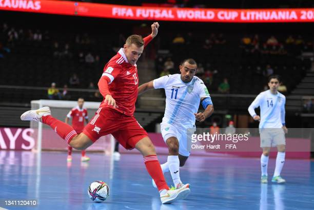 Andrei Afanasev of RFU and Alan Aguilar of Guatemala challenge for the ball during the FIFA Futsal World Cup 2021 group B match between Guatemala and...