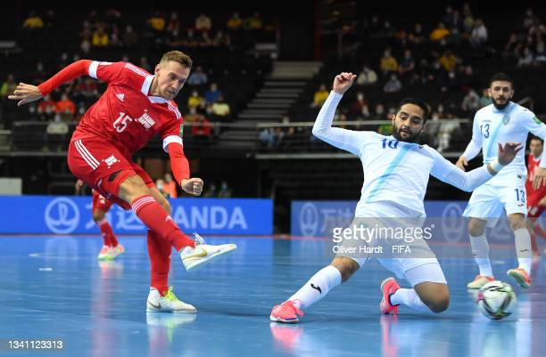 Andrei Afanasev of RFU and Marvin Sandoval of Guatemala challenge for the ball during the FIFA Futsal World Cup 2021 group B match between Guatemala...