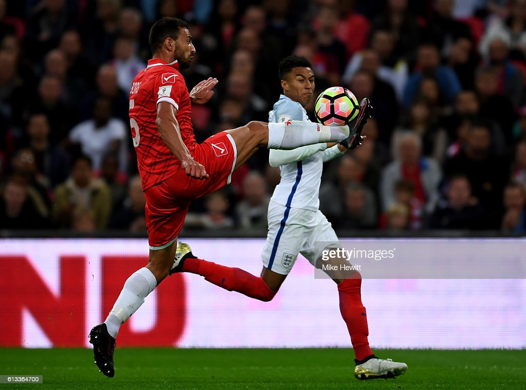 Andrei Agius of Malta controls the ball ahead of Jesse Lingard of ... 58f3cfdc4