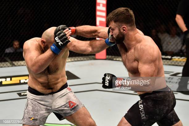 Andrei Arlovski of Belarus and Shamil Abdurakhimov of Russia exchange punches in their heavyweight bout during the UFC Fight Night event at...