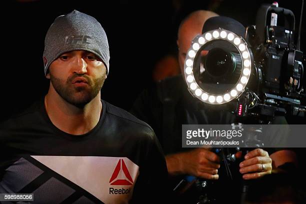 Andrei Arlovski of Belarus comes out to fight Josh Barnett of USA in their Heavyweight Bout during the UFC Fight Night held at Barclaycard Arena at...