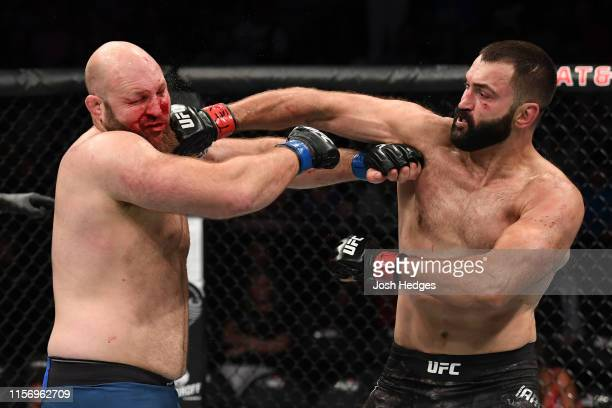 Andrei Arlovski of Belarus punches Ben Rothwell in their heavyweight bout during the UFC Fight Night event at ATT Center on July 20 2019 in San...