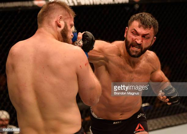 Andrei Arlovski of Belarus punches Marcin Tybura of Poland in their heavyweight bout during the UFC Fight Night event at the Singapore Indoor Stadium...