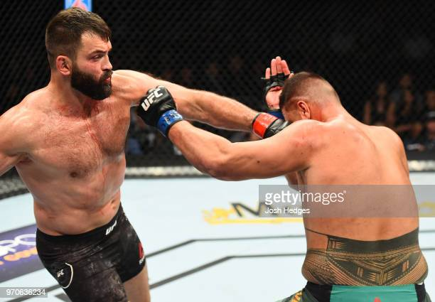 Andrei Arlovski of Belarus punches Tai Tuivasa of Australia in their heavyweight fight during the UFC 225 event at the United Center on June 9 2018...