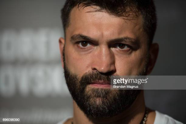 Andrei Arlovski of Belarus speaks to the media during the UFC Fight Night Ultimate Media Day at the Marina Bay Sands on June 15 2017 in Singapore