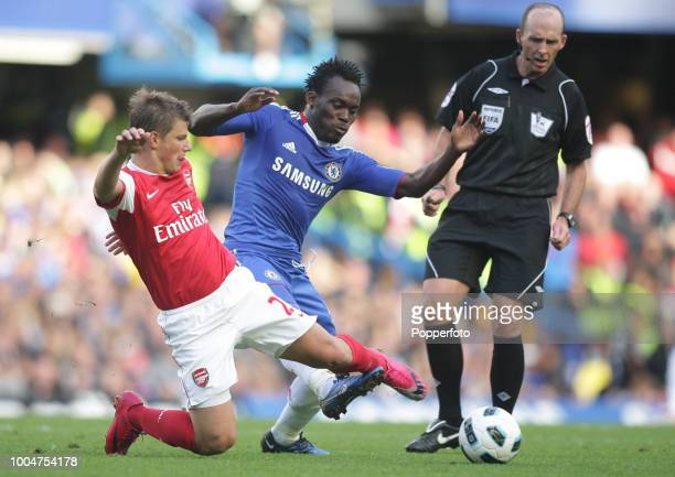 Andrei Arshavin of Arsenal and Michael Essien of Chelsea battle for the ball watched by referee Mike Dean during the Barclays Premier League match...