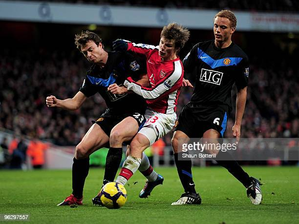 Andrei Arshavin of Arsenal is stopped by Jonathan Evans and Wes Brown of Manchester United during the Barclays Premier League match between Arsenal...