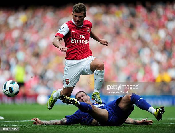 Andrei Arshavin of Arsenal is tackled by Gretar Steinsson of Bolton during the Barclays Premier League match between Arsenal and Bolton Wanderers at...