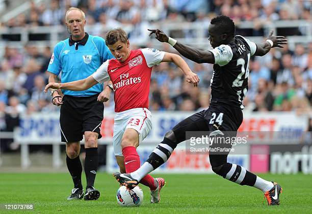 Andrei Arshavin of Arsenal takes on Chiek Tiote of Newcastle during the Barclays Premier League match between Newcastle United and Arsenal at St...