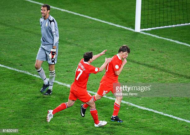 Andrei Arshavin of Russia celebrates with his team mate Konstantin Zyrianov after scoring his teams second goal while goalkeeper Andreas Isaksson of...