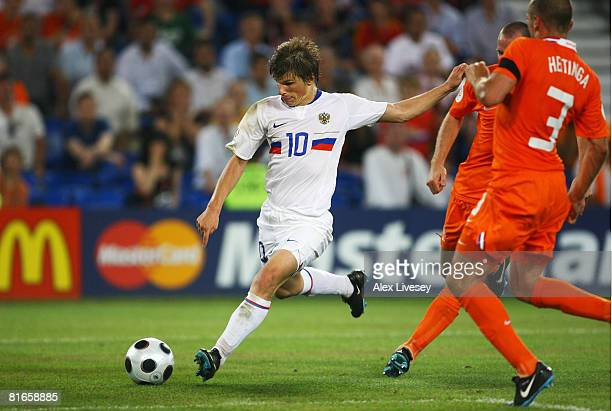 Andrei Arshavin of Russia shoots and scores Russia's third goal during the UEFA EURO 2008 Quarter Final match between Netherlands and Russia at St...