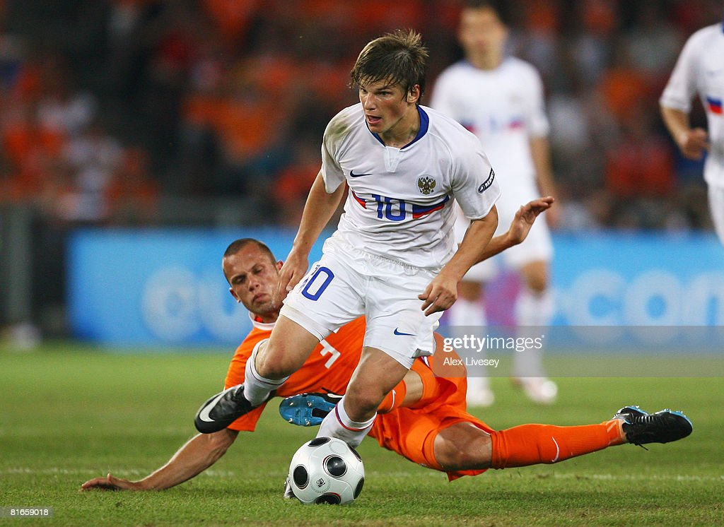 Andrei Arshavin of Russia takes the ball past John Heitinga of Netherlands during the UEFA EURO 2008 Quarter Final match between Netherlands and Russia at St. Jakob-Park on June 21, 2008 in Basel, Switzerland.