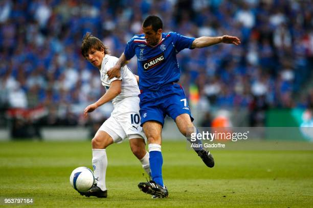 Andrei Arshavin of Zenit and Brahim Hemdani of Glasgow during the UEFA Cup Final match between Zenit Saint Petersburg and Rangers at City of...