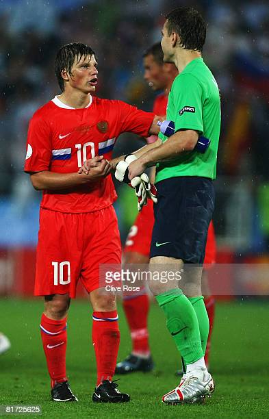 Andrei Arshavin talks to Igor Akinfeev of Russia after the UEFA EURO 2008 Semi Final match between Russia and Spain at Ernst Happel Stadion on June...