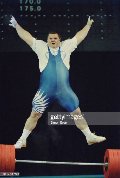 Andrei Chemerkin of Russia celebrates his gold medal winning lift in the Men's 108 kg weightlifting competition during the XXVI Summer Olympic Games...