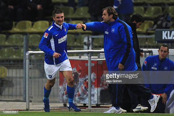 Andrei Cristea of Karlsruhe celebrates his team's first goal with head coach Rainer Scharinger during the Second Bundesliga match between Karlsruher...
