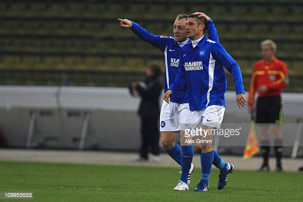 Andrei Cristea of Karlsruhe celebrates his team's first goal with team mate Aleksandr Iashvili during the Second Bundesliga match between Karlsruher...