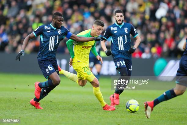 Andrei Girotto of Nantes and Ibrahim Amadou of Lille during the Ligue 1 match between Nantes and Lille OSC at Stade de la Beaujoire on February 11...