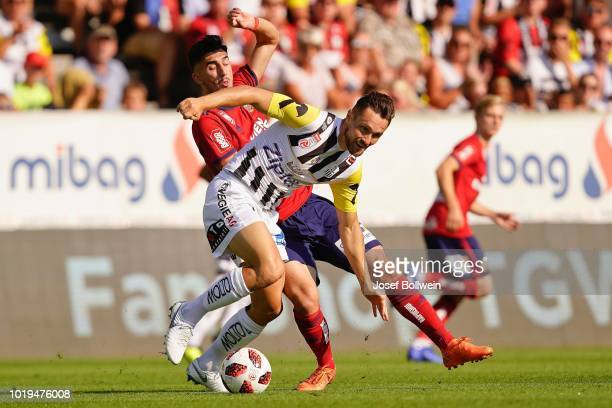 Veton Berisha of Rapid challenges Christian Ramsebner of LASK during the tipico Bundesliga match between LASK and Rapid Wien at TGW Arena on August...