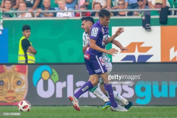 Andrei Ivan of Rapid challenges Uros Matic of Austria Wien during the tipico Bundesliga match between Rapid Wien v Austria Wien at Allianz Arena on...