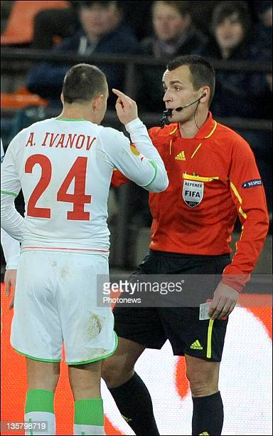 Andrei Ivanov of Moskow receiving his red card during the UEFA Europa League Group L match between RSC Anderlecht and FC Lokomotiv Moscow at the...