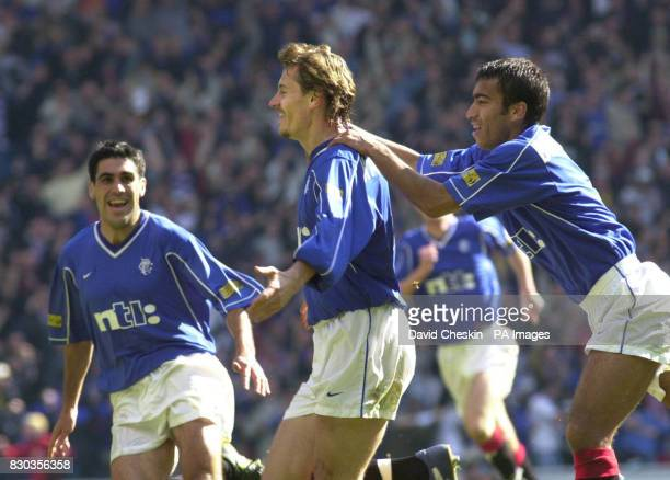 Andrei Kanchelskis celebrates with Van Bronckhorst right and Claudio Reyner left after scoring the second goal for Rangers against Celtic in the...