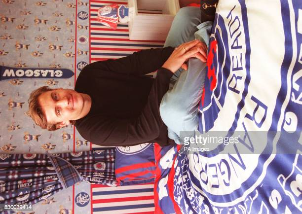 Andrei Kanchelskis from Fiorentina sits in a bedroom/shrine to Rangers in Glasgow after he was signed up with Rangers FC for 55million today The...
