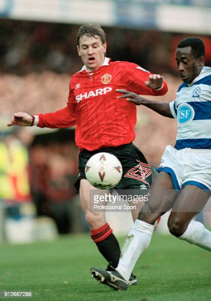 Andrei Kanchelskis of Manchester United is challanged by Clive Wilson of Queens Park Rangers during an FA Carling Premiership match at Loftus Road on...