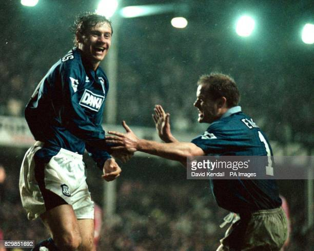 Andrei Kanchelskis turns to John Ebbrell to celebrate after scoring Everton's first goal