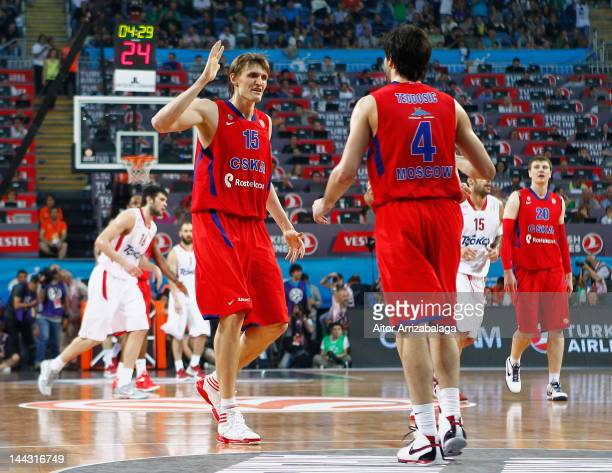 Andrei Kirilenko #15 of CSKA Moscow celebrates with team mate Milos Teodosic #4 during the Turkish Airlines EuroLeague Final Four Final match between...