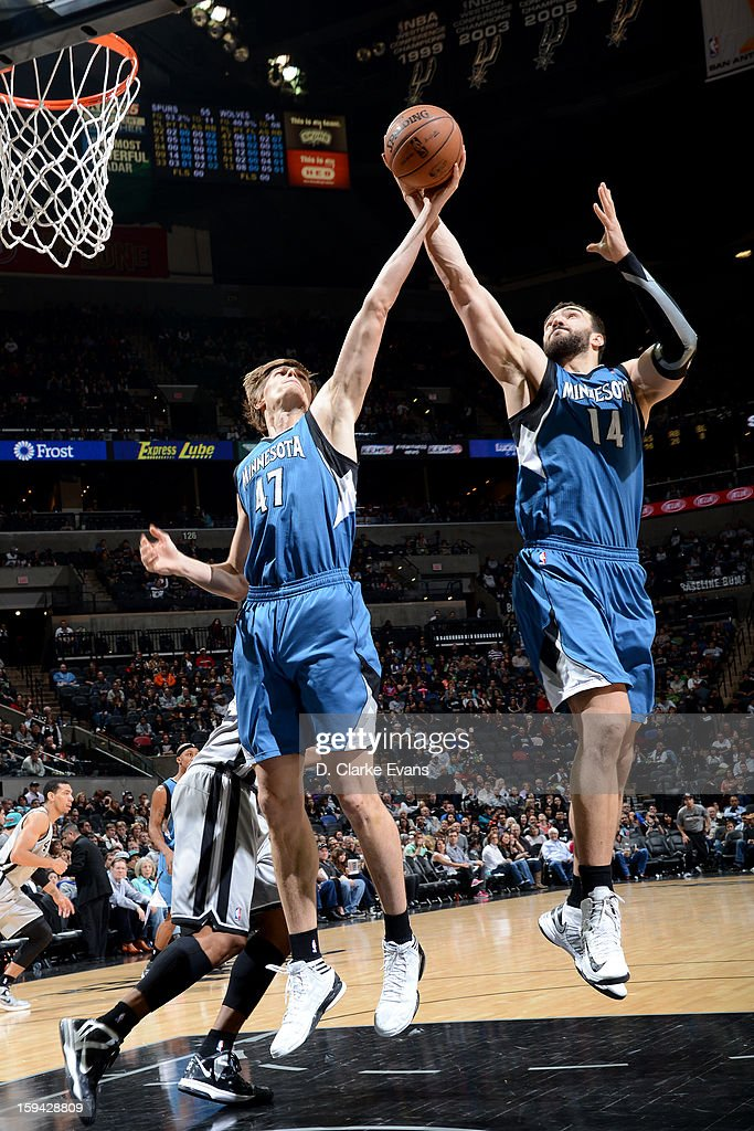 Andrei Kirilenko #47 and Nikola Pekovic #14 of the Minnesota Timberwolves grabs the rebound against the San Antonio Spurs on January 13, 2013 at the AT&T Center in San Antonio, Texas.