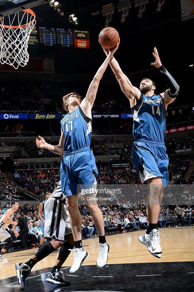 Andrei Kirilenko #47 and Nikola Pekovic #14 of the Minnesota Timberwolves grabs the rebound against the San Antonio Spurs on January 13, 2013 at the AT&T Center in San Antonio, Texas.