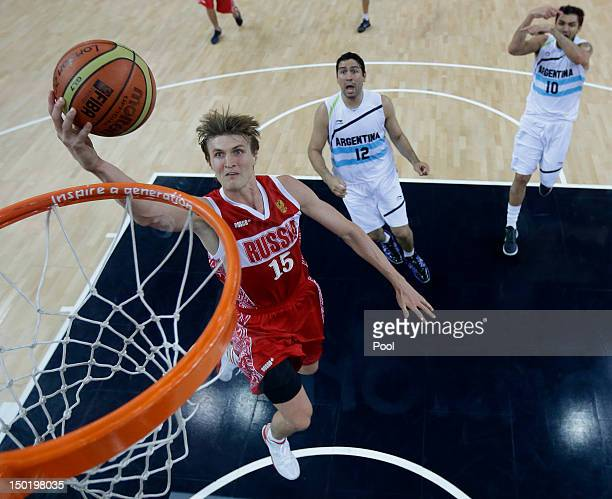 Andrei Kirilenko of Russia drives to the basket against Argentina during the Men's Basketball bronze medal game between Russia and Argentina on Day...