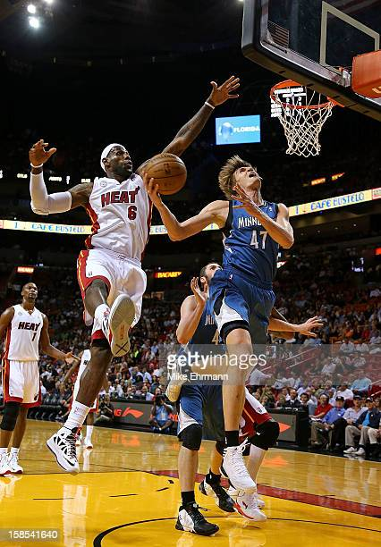 Andrei Kirilenko of the Minnesota Timberwolves drives against LeBron James of the Miami Heat during a game at American Airlines Arena on December 18...