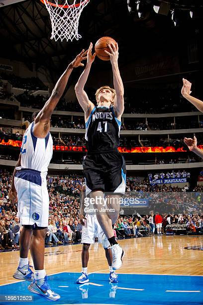 Andrei Kirilenko of the Minnesota Timberwolves drives to the basket against Elton Brand of the Dallas Mavericks on January 14 2013 at the American...
