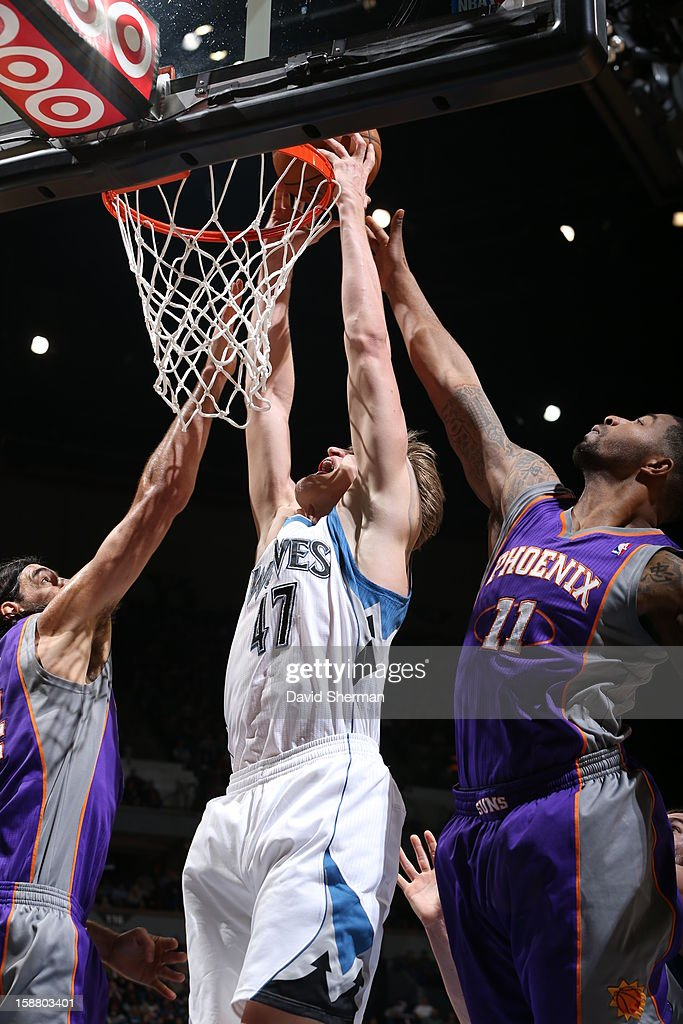 Andrei Kirilenko #47 of the Minnesota Timberwolves dunks the ball against Markieff Morris #11 of the Phoenix Suns during the game between the Minnesota Timberwolves and the Phoenix Suns during the game on December 29, 2012 at Target Center in Minneapolis, Minnesota.