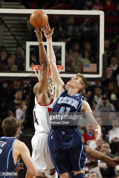 Andrei Kirilenko of the Utah Jazz and Brian Skinner of the Portland Trail Blazers battle for the ball on April 1, 2006 at the Rose Garden in...