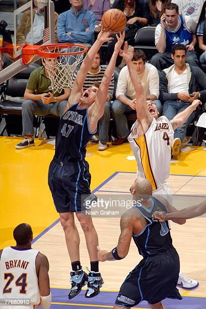 Andrei Kirilenko of the Utah Jazz battles for the rebound against Luke Walton of the Los Angeles Lakers at Staples Center on November 4 2007 in Los...