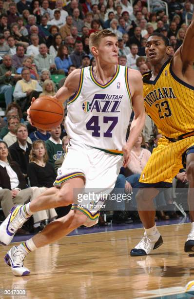 Andrei Kirilenko of the Utah Jazz dribbles against the Indiana Pacers on March 5 2004 at the Delta Center in Salt Lake City Utah NOTE TO USER User...