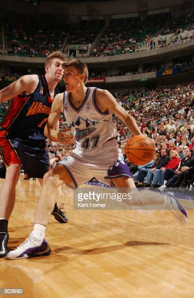 Andrei Kirilenko of the Utah Jazz dribbles around Troy Murphy of the Golden State Warriors at the Delta Center in Salt Lake City Utah DIGITAL IMAGE...