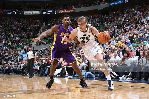 Andrei Kirilenko of the Utah Jazz drives the ball around Ron Artest of the Los Angeles Lakers at EnergySolutions Arena on November 26 2010 in Salt...