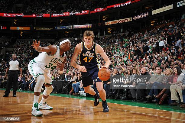 Andrei Kirilenko of the Utah Jazz drives to the basket against Paul Pierce of the Boston Celtics during the game on January 21 2011 at the TD Garden...