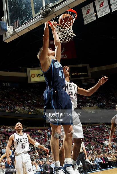 Andrei Kirilenko of the Utah Jazz dunks against Richard Jefferson of the New Jersey Nets at the Continental Airlines Arena on November 9 2005 in East...