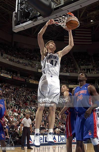 Andrei Kirilenko of the Utah Jazz dunks against the Detroit Pistons on November 13 2004 at the Delta Center in Salt Lake City Utah NOTE TO USER User...