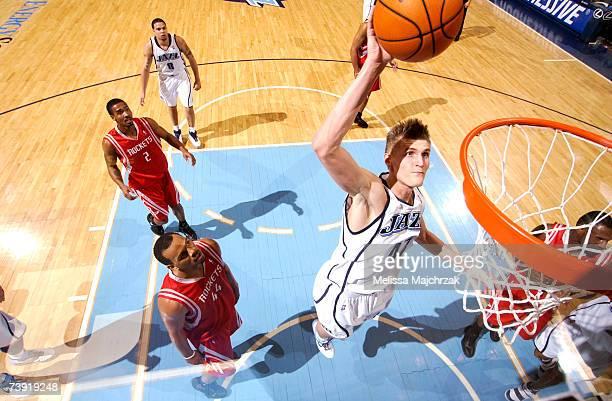 Andrei Kirilenko of the Utah Jazz dunks over Chuck Hayes of the Houston Rockets on April 18 2007 at the EnergySolutions Arena in Salt Lake City Utah...
